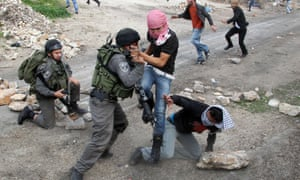 Israeli border guard detain a Palestinian protester during clashes against the expropriation of Palestinian land by Israel in the village of Kafr Qaddum, near the occupied West Bank city of Nablus.