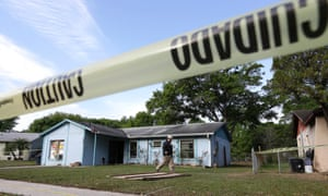An engineer surveys in front of a home where sinkhole opened up and swallowed a man in Seffner, Florida. A man screamed for help and disappeared as a large sinkhole that opened under the bedroom of the house. His brother tried to rescue him and police have been frantically searching but there's been no contact with the man since.