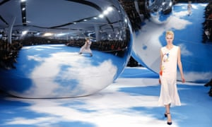 The Dior fashion show gets under way and seems to be channeling Anish Kapoor's artwork. A model presents a creation by Belgian designer Raf Simons as part of his Fall-Winter 2013/2014 women's ready-to-wear fashion show for Dior during Paris fashion week.
