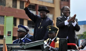 Nigerian President Goodluck Jonathan and his Ivorian counterpart Alassane Ouattara wave to the crowd during a visit to Yamoussoukro. Goodluck Jonathan is on a two-day official visit to Ivory Coast.