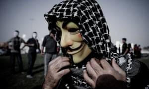 A Bahraini protester wearing a Guy Fawkes mask used by the Anonymous movement takes part in a demonstration against the government and in solidarity with jailed photographer Ahmed Humaidan in tKarranah, west of Manama. Humaidan was arrested during a rally in December 2012 and was charged with demonstrating illegally.