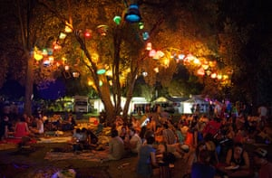 Adelaide festival day 10: Festivalgoers relax under a light installation in the trees