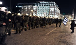 Police surround gathering demonstrators in front of the Greek parliament in Athens last night.