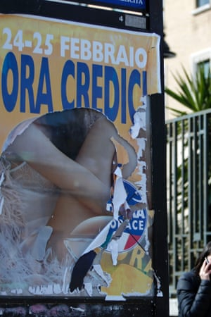 A ripped political election poster in Rome.