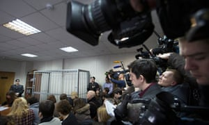 The defendants' cage stands empty as media pack the courtroom for the trial of Sergei Magnitsky