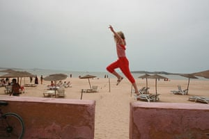 Inpics-leap: girl dressed in red trousers leaping between wall sections