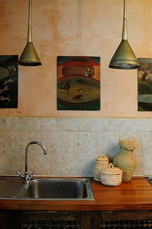 Homes - moroccan home: kitchen sink with wooden top and pendant lamps above