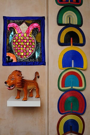 Homes - moroccan home: brightly coloured fans and tiger ornament