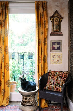 Homes - moroccan home: cat sitting on stool in front of large window