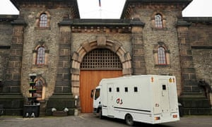 A 'sweat box' arrives at Wandsworth prison one of the jails where Chris Huhne may begin his sentence