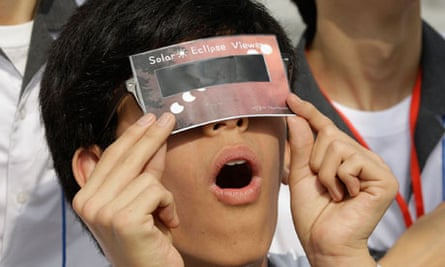 A South Korean student uses a special glass to observe the transit of Venus on June 6 2012