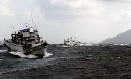 Japan coastguard and Taiwanese fishing boats