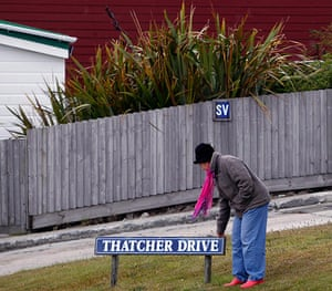 Falkland Islands: A woman touches the Thatcher Drive sign in Stanley