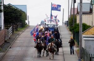 Falkland Islands: Falkland islanders lead a parade on their horses