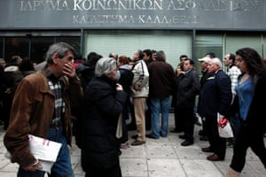 Queues outside a branch of the national social security foundation (IKA) branch in Athens today, to ensure the renewal of their social security booklets.