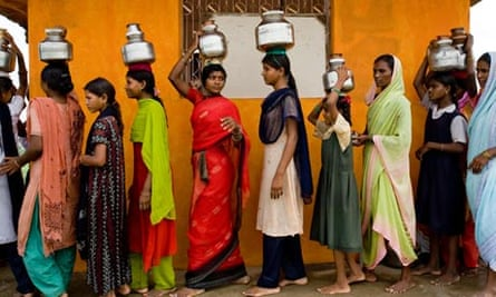 Indian women queuing for water