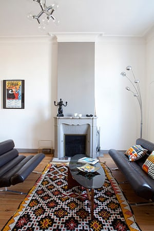 Homes - Fifties Scent: room with grey fireplace and african rug