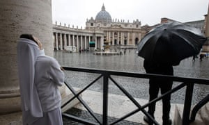 A nun looks up in St Peter's Square on the second day of the papal conclave on 13 March 2013.