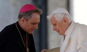 Pope Benedict XVI talks to his personal secretary George Gaenswein after his final general audience
