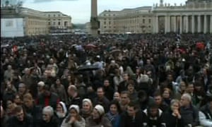 A large crowd waits in St Peter's Square for news from the papal conclave on 13 March 2013.
