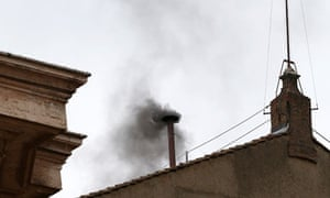 Black smoke billows from the chimney of the Sistine Chapel on the morning of 13 March 2013.