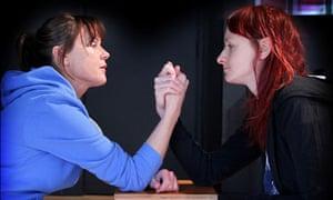 Two women arm wrestling in Hours til Midnight by Sonya Hale