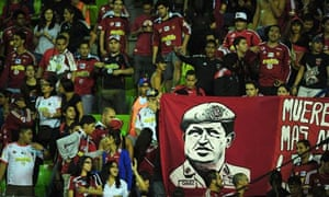 Caracas FC supporters display a banner paying tribute to the former Venezuelan president