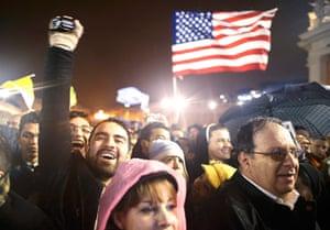 Pope elected gallery: Faithful cheer near a U.S. flag