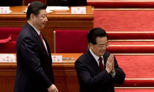 China's new president, Xi Jinping, left, is applauded by his predecessor, Hu Jintao.