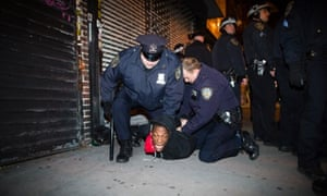 "Police officers arrest a demonstrator during a march after a vigil held for Kimani ""Kiki"" Gray in the East Flatbush neighborhood of Brooklyn. The 16-year-old was shot to death on a Brooklyn street last Saturday night by plainclothes police officers who claim the youth pointed a .38-caliber revolver at them."