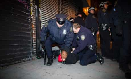 """Police officers arrest a demonstrator during a march after a vigil held for Kimani """"Kiki"""" Gray in the East Flatbush neighborhood of Brooklyn. The 16-year-old was shot to death on a Brooklyn street last Saturday night by plainclothes police officers who claim the youth pointed a .38-caliber revolver at them."""