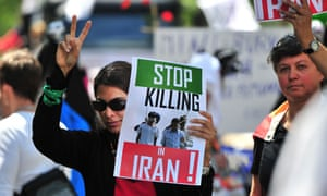 Women demonstrate against the situation in Iran during a gay pride parade in Berlin
