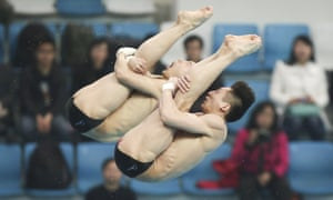 Lin Yue and Chen Aisen of China compete in the Men's 10m Platform Synchro Final during the first day one of the FINA Diving World Series in Beijing, China.