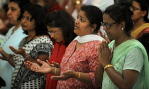 Indian Catholics pray during a Friday afternoon service at the Holy Name cathedral in Mumbai on today. With around 17 million Catholics, India is home to the Church's second largest community in Asia after the Philippines.