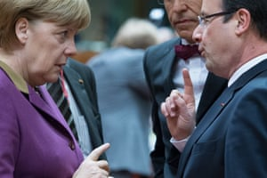 Caption competition? German chancellor Angela Merkel chats with French President François Hollande at the summit earlier today.