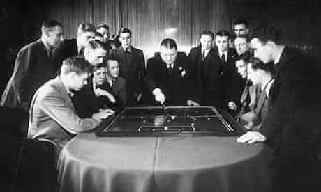 Arsenal football club manager George Allison rehearsing tactics with the team, November 1938.