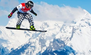 Flying man: Nick Baumgartner of the USA in action during the men's snowboard cross World Cup qualification race in Veysonnaz, Switzerland, today.