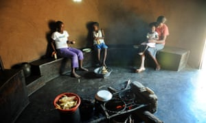 Members of a family eat a meal in their home in Domboshava north of Harare the day before people in Zimbabwe go to the polls to vote in a constitutional referendum that would guarantee democracy in future elections in the country.