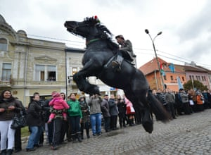 A man rides a horse during a parade to mark National Day in Targu Secuiesc, Romania