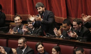 Five Star Movement lawmakers sit at the back as the Italian parliament reconvenes