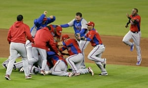 Puerto Rico's players pile on after defeating Team USA 4-3 to reach the Championship Round of the World Baseball Classic on Friday. (AP Photo/Wilfredo Lee)