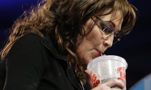 Former Alaska governor Sarah Palin drinks a large soda for comic effect at CPAC.