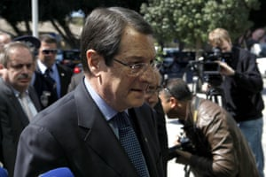 Cypriot President Nicos Anastasiades arrives at the parliament before a meeting in capital Nicosia, Cyprus, Monday, March 18, 2013.
