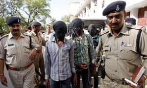 Indian police escort the accused to court