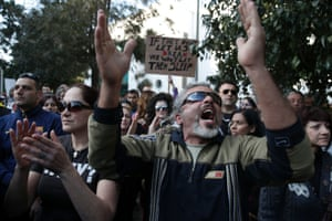 Protesters shout slogans during an anti-bailout rally outside the parliament in Nicosia  March 18, 2013.