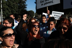 Protesters shout slogans during a protest outside of the parliament in Nicosia, Cyprus, Monday, March 18, 2013