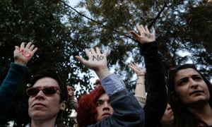 "Protesters raise their open palms showing the word ""No"" during an anti-bailout rally outside the parliament in Nicosia  March 18, 2013."