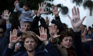 """Cypriots show their palms reading """"No"""""""