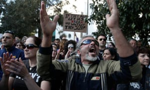 Cypriots protest against the bailout outside the parliament in Nicosia