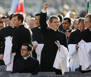 Inaugural Mass: A young priest punches the air